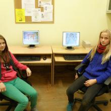 Two girls with their computers, showing how they make animated films.