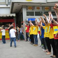 Young people taking part in a 'No to TB!' flash mob in the town shopping area.