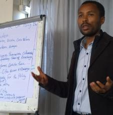 An open access policy workshop participant presents group work results - and open access policy draft for Addis Ababa University