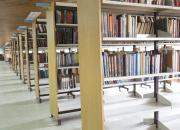 rows of book shelves in a library