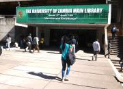 Students walk into the University of Zambia library.