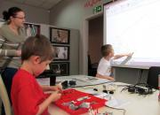 Kids assembling LEGO robots in the library
