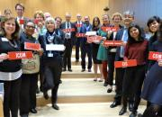 Representatives from the library, archive, museum and education sectors at SCCR/37. They are in the hall, holding names to identify organisations.