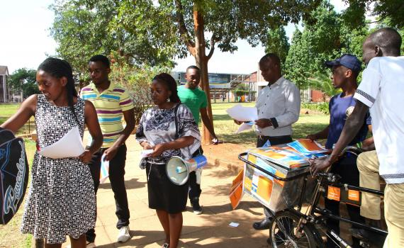 Student open access campaigners at Harare Institute of Technology used a megaphone to broadcast messages and a bicycle to distribute pamphlets during Open Access Week 2015. Photo by Jasper Lee Maenzanise.