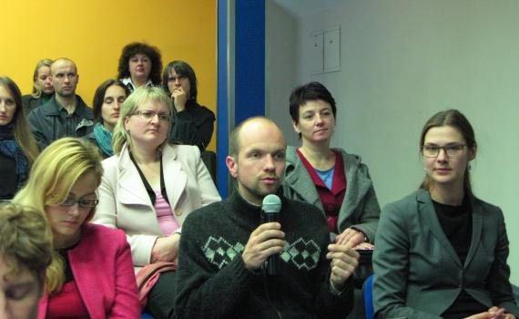 A group of researchers and scientists promoting open access at a meeting.